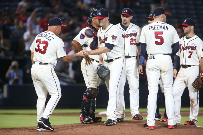 Aug 10, 2014; Atlanta, GA, USA; Atlanta Braves starting pitcher Alex Wood (40) is relieved by Atlanta Braves manager Fredi Gonzalez (33, left) during a pitching change in their game against the Washington Nationals at Turner Field. The Braves won 3-1. Mandatory Credit: Jason Getz-USA TODAY Sports
