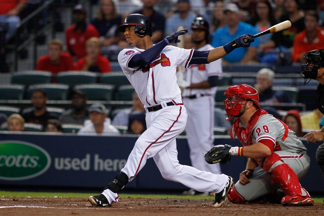 Jul 18, 2014; Atlanta, GA, USA; Atlanta Braves catcher Christian Bethancourt (25) swings the bat against the Philadelphia Phillies in the second inning at Turner Field. Mandatory Credit: Brett Davis-USA TODAY Sports