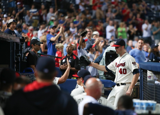 Aug 10, 2014; Atlanta, GA, USA; Atlanta Braves starting pitcher Alex Wood (40) is cheered by fans and greeted in the dugout after leaving the game against the Washington Nationals at Turner Field. The Braves won 3-1. Mandatory Credit: Jason Getz-USA TODAY Sports
