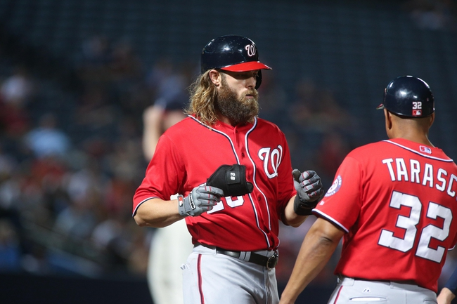 Aug 10, 2014; Atlanta, GA, USA; Washington Nationals right fielder Jayson Werth (28) celebrates a hit with Washington Nationals first base coach Tony Tarasco (32) during their game against the Atlanta Braves at Turner Field. The Braves won 3-1. Mandatory Credit: Jason Getz-USA TODAY Sports