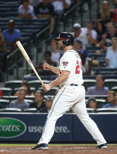 Aug 10, 2014; Atlanta, GA, USA; Atlanta Braves catcher Evan Gattis (24) pitch hits in the eighth inning against the Washington Nationals at Turner Field. The Braves won 3-1. Mandatory Credit: Jason Getz-USA TODAY Sports
