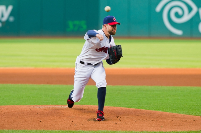 Aug 15, 2014; Cleveland, OH, USA; Cleveland Indians starting pitcher Corey Kluber (28) pitches during the first inning against the Baltimore Orioles at Progressive Field. Mandatory Credit: Ken Blaze-USA TODAY Sports