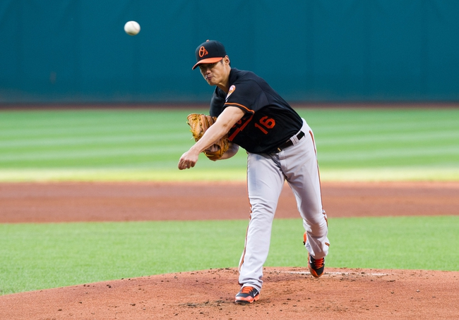Aug 15, 2014; Cleveland, OH, USA; Baltimore Orioles starting pitcher Wei-Yin Chen (16) pitches during the first inning against the Cleveland Indians at Progressive Field. Mandatory Credit: Ken Blaze-USA TODAY Sports