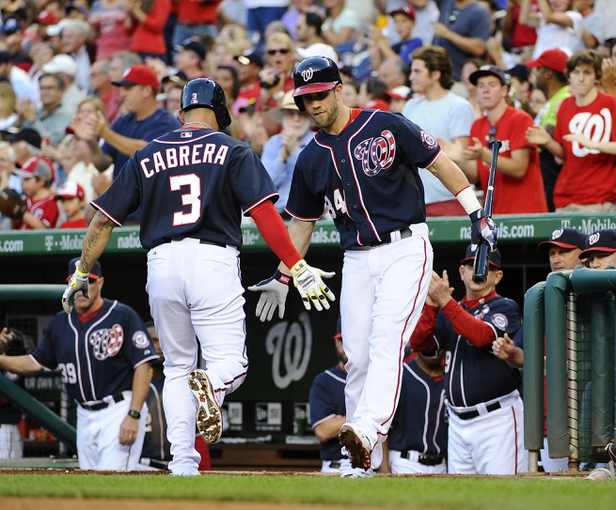 Aug 15, 2014; Washington, DC, USA; Washington Nationals second baseman Asdrubal Cabrera (3) is congratulated by left fielder Bryce Harper (34) after scoring a run against the Pittsburgh Pirates during the first at Nationals Park. Mandatory Credit: Brad Mills-USA TODAY Sports