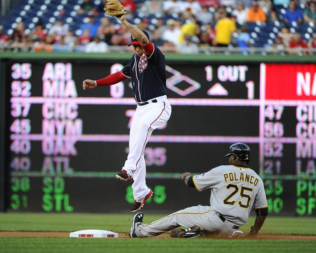 Aug 15, 2014; Washington, DC, USA; Pittsburgh Pirates right fielder Gregory Polanco (25) steals second base in front of a leaping Washington Nationals second baseman Asdrubal Cabrera (3) during the second at Nationals Park. Mandatory Credit: Brad Mills-USA TODAY Sports