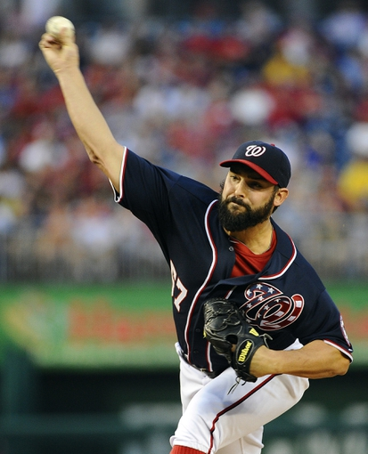 Aug 15, 2014; Washington, DC, USA; Washington Nationals starting pitcher Tanner Roark (57) throws during the second inning against the Pittsburgh Pirates at Nationals Park. Mandatory Credit: Brad Mills-USA TODAY Sports