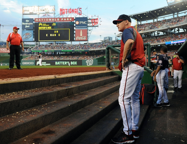 Aug 15, 2014; Washington, DC, USA; Washington Nationals manager Matt Williams (9) in the dugout against the Pittsburgh Pirates during the second at Nationals Park. Mandatory Credit: Brad Mills-USA TODAY Sports
