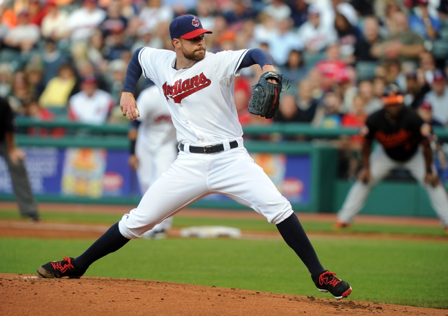 Aug 15, 2014; Cleveland, OH, USA; Cleveland Indians starting pitcher Corey Kluber (28) pitches during the third inning against the Baltimore Orioles at Progressive Field. Mandatory Credit: Ken Blaze-USA TODAY Sports