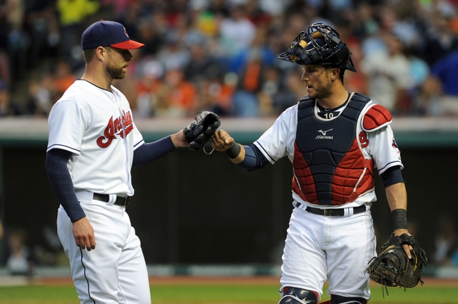 Aug 15, 2014; Cleveland, OH, USA; Cleveland Indians catcher Yan Gomes (10) congratulates Cleveland Indians starting pitcher Corey Kluber (28) after Kluber struck out the side during the fifth inning against the Baltimore Orioles at Progressive Field. Mandatory Credit: Ken Blaze-USA TODAY Sports