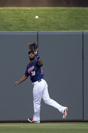 Aug 15, 2014; Minneapolis, MN, USA; Minnesota Twins center fielder Danny Santana (39) catches a fly ball in the first inning against the Kansas City Royals at Target Field. Mandatory Credit: Jesse Johnson-USA TODAY Sports