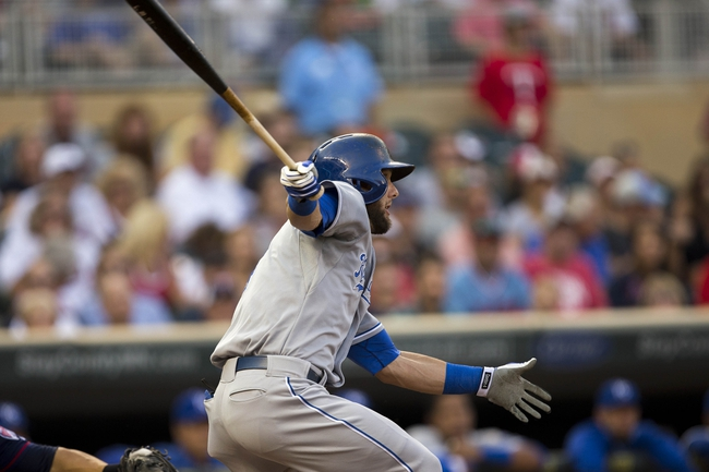 Aug 15, 2014; Minneapolis, MN, USA; Kansas City Royals left fielder Alex Gordon (4) hits a single in the second inning against the Minnesota Twins at Target Field. Mandatory Credit: Jesse Johnson-USA TODAY Sports