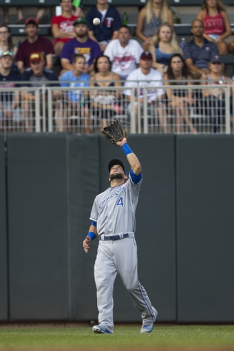 Aug 15, 2014; Minneapolis, MN, USA; Kansas City Royals left fielder Alex Gordon (4) catches a fly ball in the second inning against the Minnesota Twins at Target Field. Mandatory Credit: Jesse Johnson-USA TODAY Sports