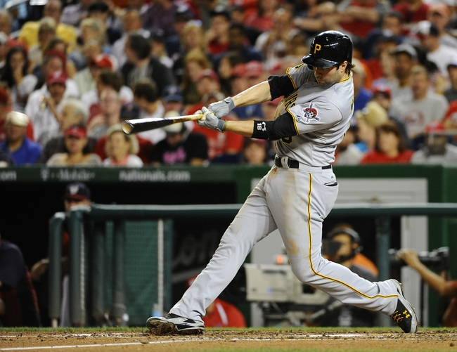 Aug 15, 2014; Washington, DC, USA; Pittsburgh Pirates second baseman Neil Walker (18) hits a double against the Washington Nationals during the fourth inning at Nationals Park. Mandatory Credit: Brad Mills-USA TODAY Sports