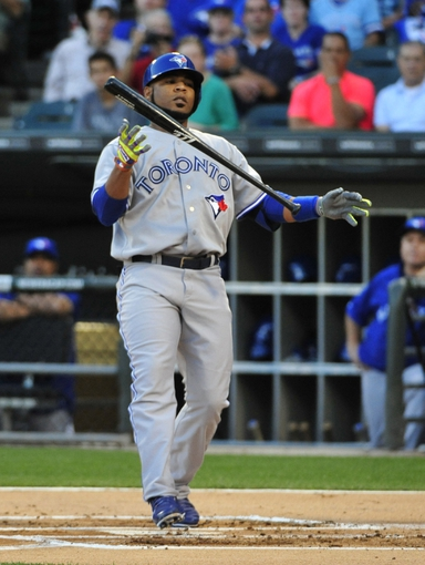 Aug 15, 2014; Chicago, IL, USA; Toronto Blue Jays designated hitter Edwin Encarnacion (10)  reacts after striking out against the Chicago White Sox during the first inning at U.S Cellular Field. Mandatory Credit: David Banks-USA TODAY Sports