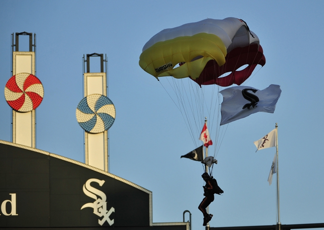 Aug 15, 2014; Chicago, IL, USA; The Airborne Veterans parachute into the ballpark before the game between the Chicago White Sox and the Toronto Blue Jays at U.S Cellular Field. Mandatory Credit: David Banks-USA TODAY Sports