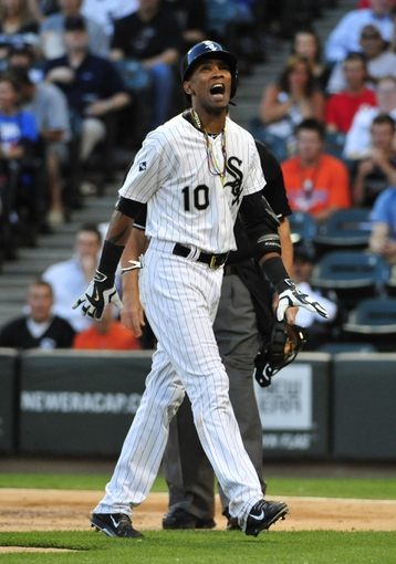Aug 15, 2014; Chicago, IL, USA; Chicago White Sox shortstop Alexei Ramirez (10) reacts after getting hit by a pitch against the Toronto Blue Jays during the first inning at U.S Cellular Field. Mandatory Credit: David Banks-USA TODAY Sports