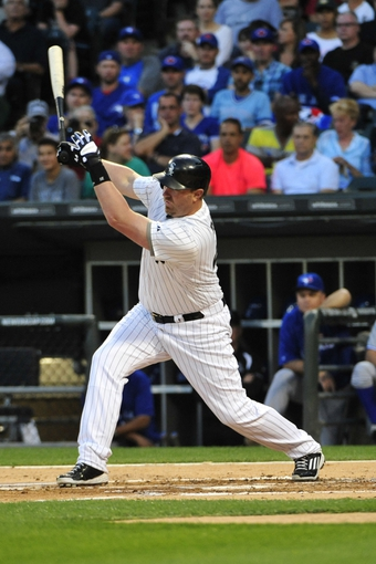 Aug 15, 2014; Chicago, IL, USA; Chicago White Sox designated hitter Adam Dunn (44) hits an RBI ground out against the Toronto Blue Jays during the first inning at U.S Cellular Field. Mandatory Credit: David Banks-USA TODAY Sports