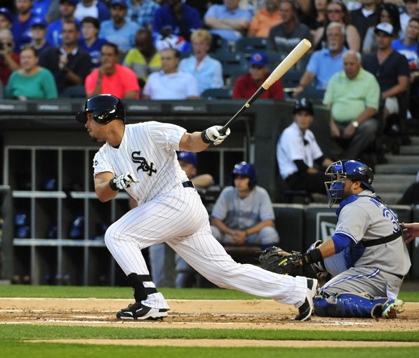 Aug 15, 2014; Chicago, IL, USA;  Chicago White Sox first baseman Jose Abreu (79) hits an RBI single against the Toronto Blue Jays during the first inning at U.S Cellular Field. Mandatory Credit: David Banks-USA TODAY Sports