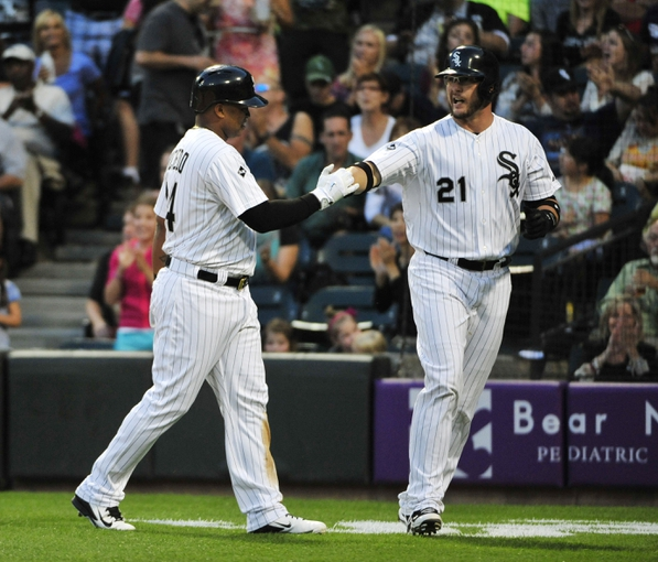 Aug 15, 2014; Chicago, IL, USA; Chicago White Sox right fielder Dayan Viciedo (24) is greeted by catcher Tyler Flowers (21) after scoring against the Toronto Blue Jays during the first inning at U.S Cellular Field. Mandatory Credit: David Banks-USA TODAY Sports