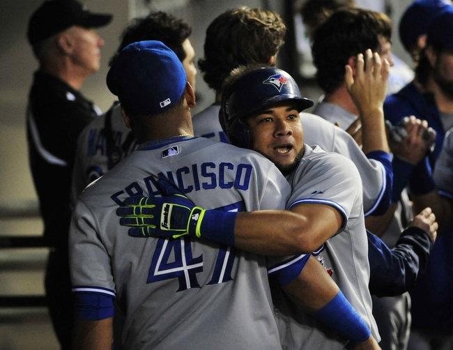 Aug 15, 2014; Chicago, IL, USA; Toronto Blue Jays left fielder Melky Cabrera (53) hugs third baseman Juan Francisco (47) after he hit a two-run homer against the Chicago White Sox during the second inning at U.S Cellular Field. Mandatory Credit: David Banks-USA TODAY Sports