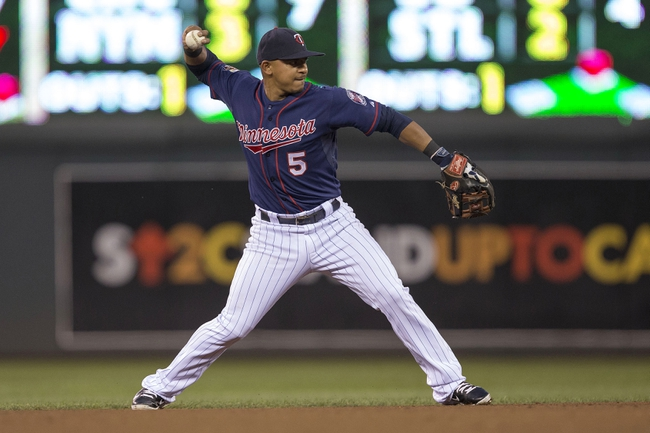 Aug 15, 2014; Minneapolis, MN, USA; Minnesota Twins shortstop Eduardo Escobar (5) throws the ball to first base in the fourth inning against the Kansas City Royals at Target Field. Mandatory Credit: Jesse Johnson-USA TODAY Sports