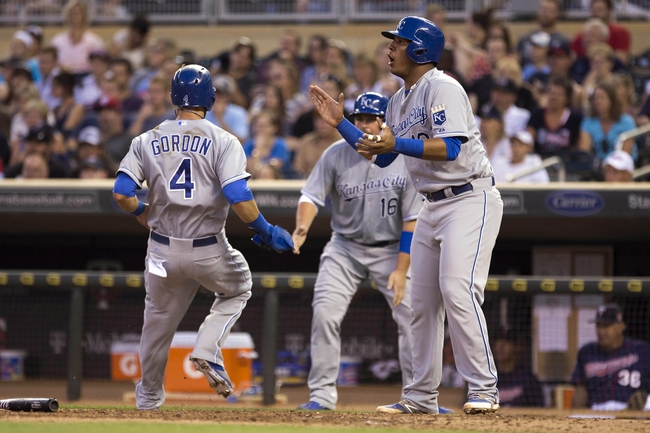 Aug 15, 2014; Minneapolis, MN, USA; Kansas City Royals catcher Salvador Perez (13) reacts to designated hitter Josh Willingham (not pictured) after scoring a run in the fourth inning against the Minnesota Twins at Target Field. Mandatory Credit: Jesse Johnson-USA TODAY Sports