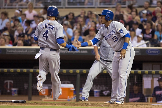 Aug 15, 2014; Minneapolis, MN, USA; Kansas City Royals catcher Salvador Perez (13) celebrates with left fielder Alex Gordon (4) after scoring runs in the fourth inning against the Minnesota Twins at Target Field. Mandatory Credit: Jesse Johnson-USA TODAY Sports