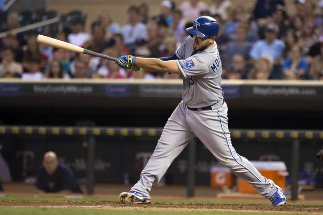 Aug 15, 2014; Minneapolis, MN, USA; Kansas City Royals third baseman Mike Moustakas (8) hits a single in the fourth inning against the Minnesota Twins at Target Field. Mandatory Credit: Jesse Johnson-USA TODAY Sports