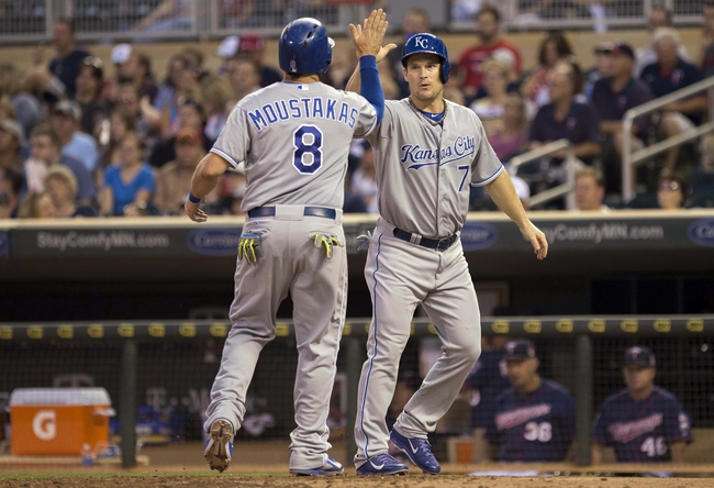 Aug 15, 2014; Minneapolis, MN, USA; Kansas City Royals designated hitter Josh Willingham (7) celebrates with third baseman Mike Moustakas (8) after scoring runs in the fourth inning against the Minnesota Twins at Target Field. Mandatory Credit: Jesse Johnson-USA TODAY Sports