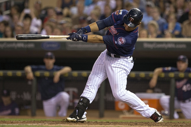Aug 15, 2014; Minneapolis, MN, USA; Minnesota Twins right fielder Oswaldo Arcia (31) hits a RBI fielders choice in the fourth inning against the Kansas City Royals at Target Field. Mandatory Credit: Jesse Johnson-USA TODAY Sports