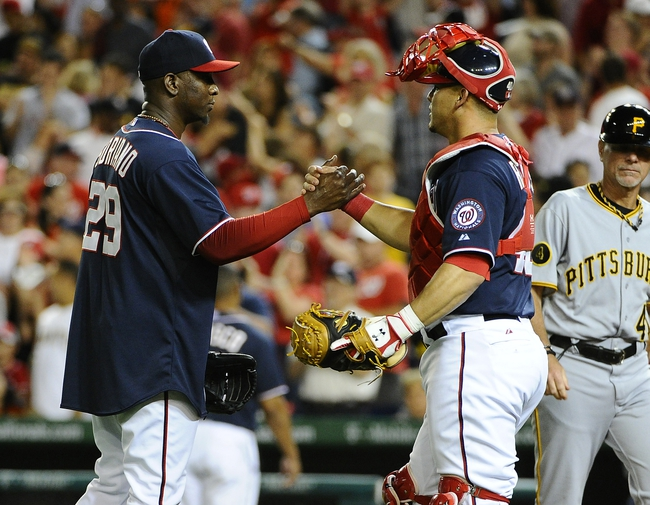 Aug 15, 2014; Washington, DC, USA; Washington Nationals relief pitcher Rafael Soriano (29) is congratulated by catcher Wilson Ramos (40) after earning a save against the Pittsburgh Pirates at Nationals Park. Mandatory Credit: Brad Mills-USA TODAY Sports