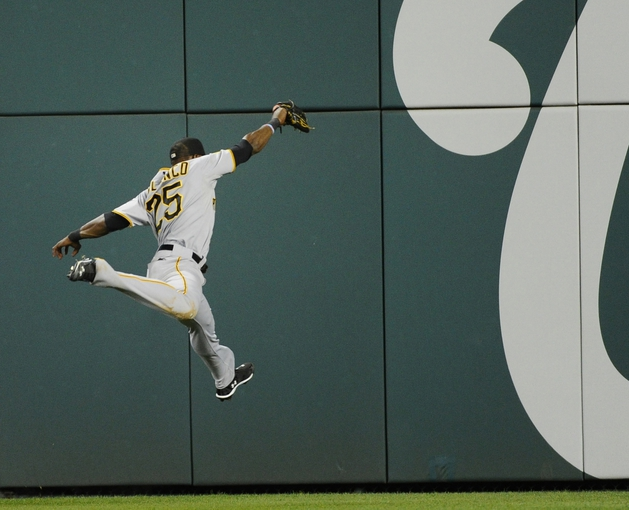Aug 15, 2014; Washington, DC, USA; Pittsburgh Pirates right fielder Gregory Polanco (25) makes a leaping catch of Washington Nationals catcher Wilson Ramos (40) fly ball during the eighth inning at Nationals Park. Mandatory Credit: Brad Mills-USA TODAY Sports