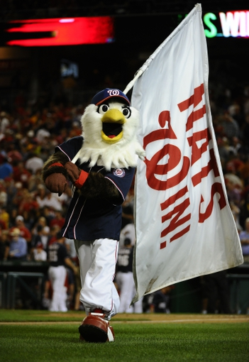 Aug 15, 2014; Washington, DC, USA; Washington Nationals mascot Screech waves a flag after the game against the Pittsburgh Pirates at Nationals Park. Mandatory Credit: Brad Mills-USA TODAY Sports