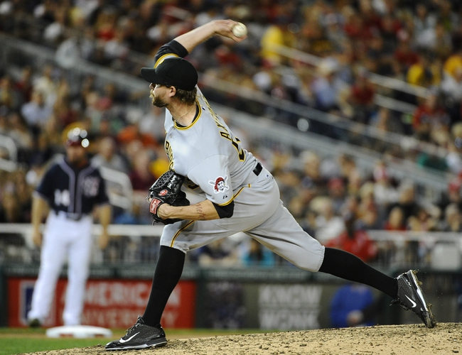 Aug 15, 2014; Washington, DC, USA; Pittsburgh Pirates pitcher John Axford throws against the Washington Nationals during the eighth inning at Nationals Park. Mandatory Credit: Brad Mills-USA TODAY Sports