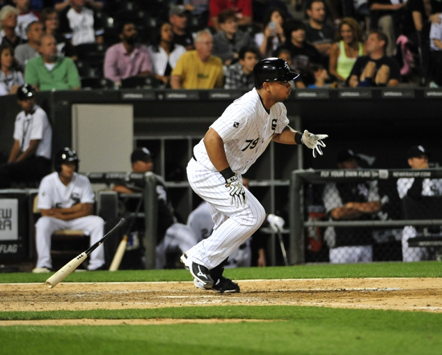 Aug 15, 2014; Chicago, IL, USA; Chicago White Sox first baseman Jose Abreu (79) hits a two RBI single against the Toronto Blue Jays during the fifth inning at U.S Cellular Field. Mandatory Credit: David Banks-USA TODAY Sports