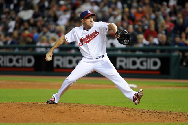 Aug 15, 2014; Cleveland, OH, USA; Cleveland Indians relief pitcher Scott Atchison (48) pitches during the eleventh inning against the Baltimore Orioles at Progressive Field. The Indians won 2-1. Mandatory Credit: Ken Blaze-USA TODAY Sports