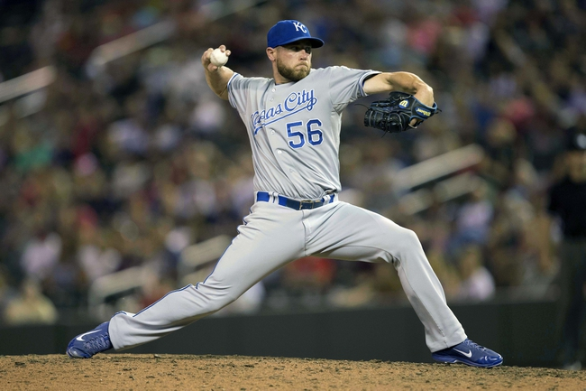 Aug 15, 2014; Minneapolis, MN, USA; Kansas City Royals relief pitcher Greg Holland (56) delivers a pitch in the ninth inning against the Minnesota Twins at Target Field. The Royals won 6-5. Mandatory Credit: Jesse Johnson-USA TODAY Sports