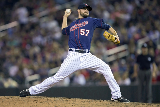 Aug 15, 2014; Minneapolis, MN, USA; Minnesota Twins relief pitcher Ryan Pressly (57) delivers a pitch in the ninth inning against the Kansas City Royals at Target Field. The Royals won 6-5. Mandatory Credit: Jesse Johnson-USA TODAY Sports