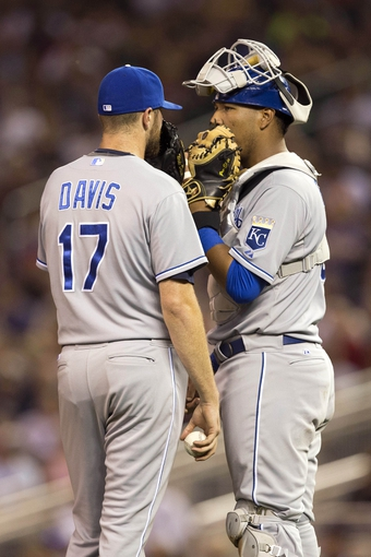 Aug 15, 2014; Minneapolis, MN, USA; Kansas City Royals catcher Salvador Perez (13) talks to relief pitcher Wade Davis (17) in the eighth inning against the Minnesota Twins at Target Field. The Royals won 6-5. Mandatory Credit: Jesse Johnson-USA TODAY Sports
