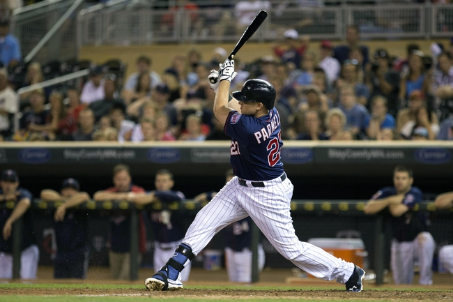 Aug 15, 2014; Minneapolis, MN, USA; Minnesota Twins pinch hitter Chris Parmelee (27) hits a RBI fielders choice in the ninth inning against the Kansas City Royals at Target Field. The Royals won 6-5. Mandatory Credit: Jesse Johnson-USA TODAY Sports