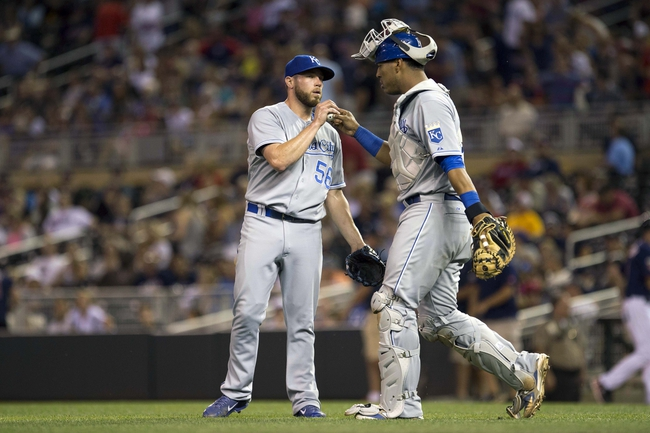 Aug 15, 2014; Minneapolis, MN, USA; Kansas City Royals relief pitcher Greg Holland (56) celebrates with catcher Salvador Perez (13) after beating the Minnesota Twins at Target Field. The Royals won 6-5. Mandatory Credit: Jesse Johnson-USA TODAY Sports