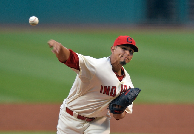 Aug 16, 2014; Cleveland, OH, USA; Cleveland Indians starting pitcher Carlos Carrasco (59) delivers a pitch in the second inning against the Baltimore Orioles at Progressive Field. Mandatory Credit: David Richard-USA TODAY Sports