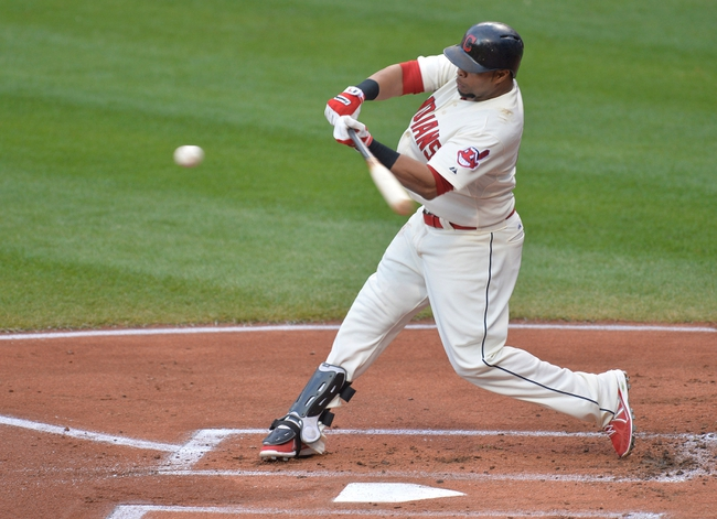 Aug 16, 2014; Cleveland, OH, USA; Cleveland Indians first baseman Carlos Santana (41) hits a three-run home run in the first inning against the Baltimore Orioles at Progressive Field. Mandatory Credit: David Richard-USA TODAY Sports