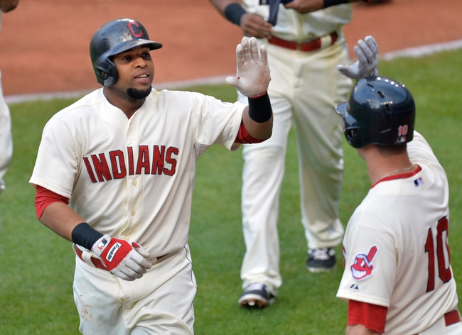 Aug 16, 2014; Cleveland, OH, USA; Cleveland Indians first baseman Carlos Santana (41) celebrates his three-run home run in the first inning against the Baltimore Orioles at Progressive Field. Mandatory Credit: David Richard-USA TODAY Sports