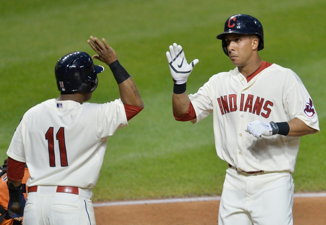 Aug 16, 2014; Cleveland, OH, USA; Cleveland Indians left fielder Michael Brantley (right) celebrates his two-run home run with shortstop Jose Ramirez (11) in the fifth inning against the Baltimore Orioles at Progressive Field. Mandatory Credit: David Richard-USA TODAY Sports