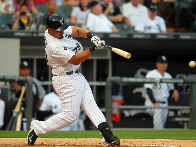 Aug 16, 2014; Chicago, IL, USA; Chicago White Sox first baseman Jose Abreu (79) hits a single during the fourth inning against the Toronto Blue Jays at U.S Cellular Field. Mandatory Credit: Dennis Wierzbicki-USA TODAY Sports