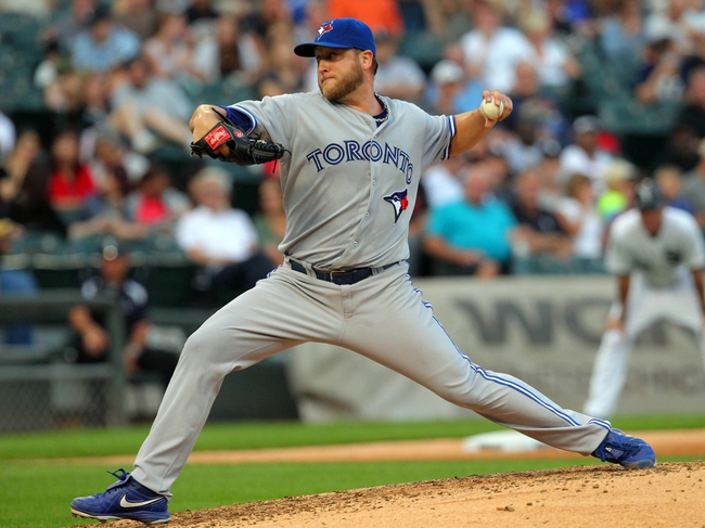 Aug 16, 2014; Chicago, IL, USA; Toronto Blue Jays starting pitcher Mark Buehrle (56) delivers a pitch during the fourth inning against the Chicago White Sox at U.S Cellular Field. Mandatory Credit: Dennis Wierzbicki-USA TODAY Sports