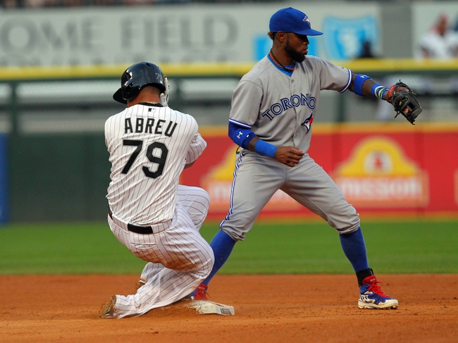 Aug 16, 2014; Chicago, IL, USA; Chicago White Sox first baseman Jose Abreu (79) slides safely into second base with Toronto Blue Jays shortstop Jose Reyes (7) taking the throw during the fourth inning at U.S Cellular Field. Mandatory Credit: Dennis Wierzbicki-USA TODAY Sports