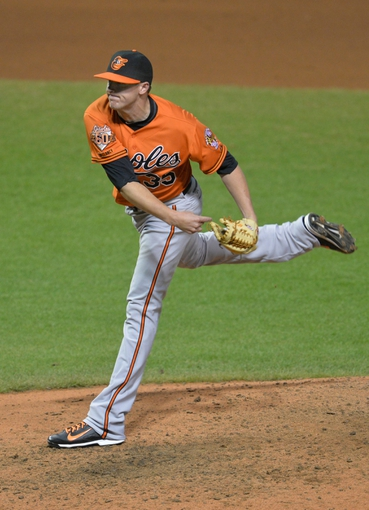 Aug 16, 2014; Cleveland, OH, USA; Baltimore Orioles relief pitcher Brad Brach (35) delivers a pitch in the seventh inning against the Cleveland Indians at Progressive Field. Mandatory Credit: David Richard-USA TODAY Sports