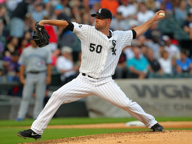 Aug 16, 2014; Chicago, IL, USA; Chicago White Sox starting pitcher John Danks (50) delivers a pitch during the fifth inning against the Toronto Blue Jays at U.S Cellular Field. Mandatory Credit: Dennis Wierzbicki-USA TODAY Sports